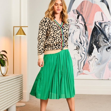 Marley Cardigan on model with green skirt in apartment