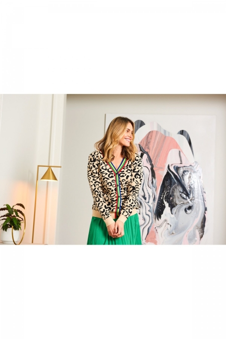 Marley Cardigan on a model with painting behind her