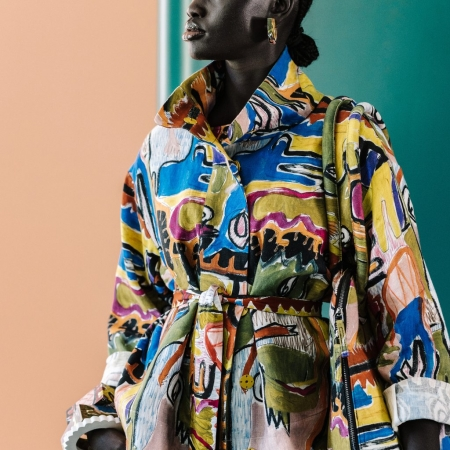 Mostro Jacket on a model with colour background and Elk jewellery