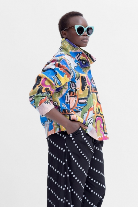 Mostro Jacket on a model wth sunglasses and navy trousers