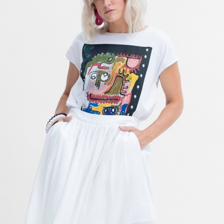 Mostro Tee on a model with a white skirt and elk jewellery