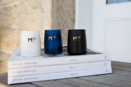 Sage and Cedar Soy Candle Trio on a stack of books