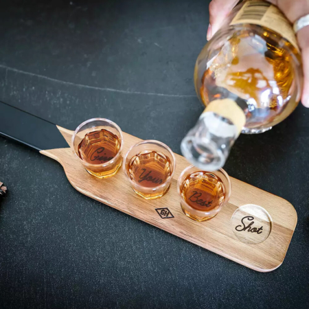 Serving Paddle and Shot Glasses with shots being poured